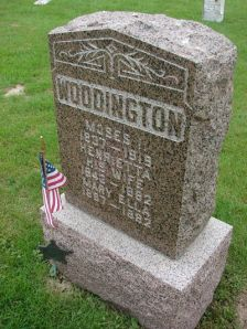Gravestone of Moses, Henrietta (Munson), and Mary Ella Woodington
